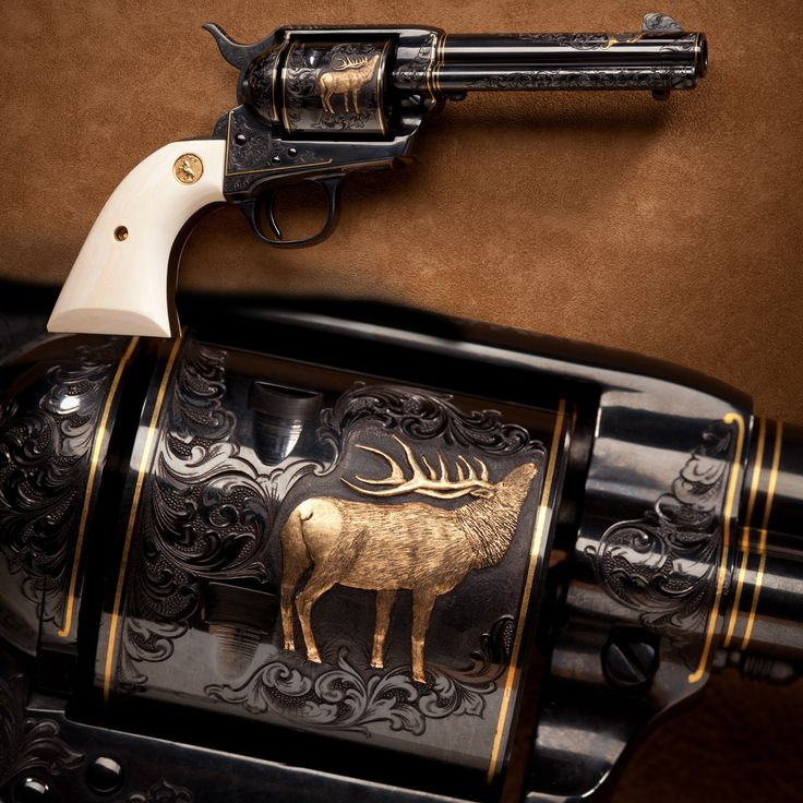 Engraved Colt Single Action Army - This engraved Colt Single Action Army revolver from the Petersen Gallery makes at least one member of our museum staff feel like he's back in the Big Horn Mountains of Wyoming. Up nearly two miles high, you can see elk like the inlaid gold example on this revolver's cylinder bugling next to crystal clear streams.  An ivory-gripped Colt like this one might be just the choice for a memento of a favorite hunting trip. NRA National Firearms Museum in Fairfax…