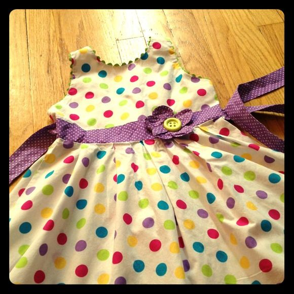 🌺SOLD🌺 Girls Adorable Polka dot Spring dress So cute white dress with pink, yellow, green, blue and purple polka dots ~ very twirly and fun 🌺 Center sash and bottom trimmed in purple w/white polka dots. Zipper closure, tie back. Gently loved. Girls size 6. From a smoke free home 🚭❤ Rare Too! Dresses