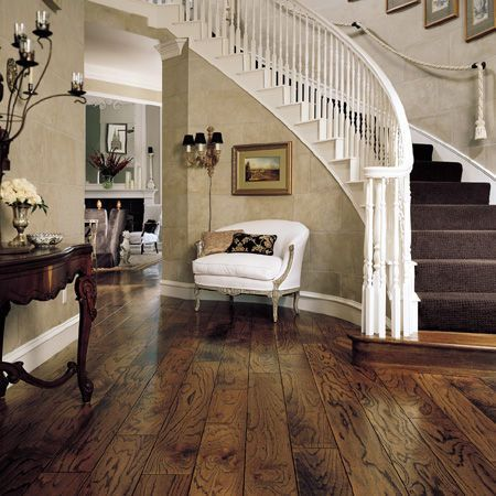 Love these floor boards asnd the sweeping staircase