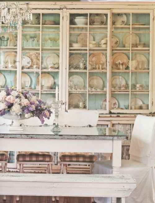 love the color painted inside china hutch with pink & white dishes