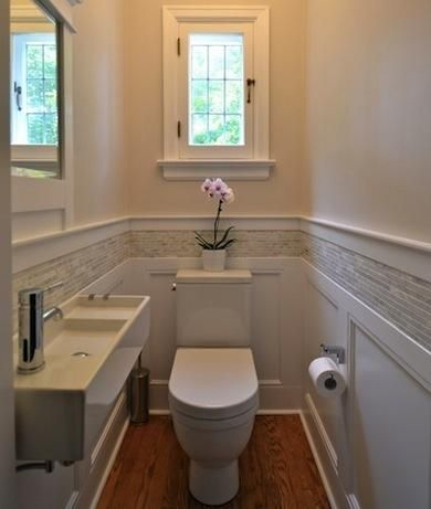 | 20 ways to make a small bathroom big - Yahoo Homes I like the combo of the wainscoting with the tile border.  very nice.  maybe for my master bath?