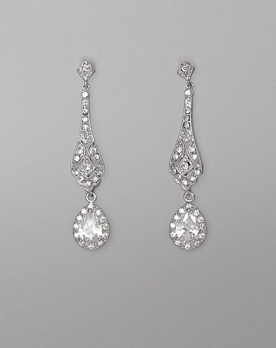 Elegant modern-vintage Bridal earrings have been designed in a delicate open-work style studded with cz crystals adding a gorgeous delicate sparkle to