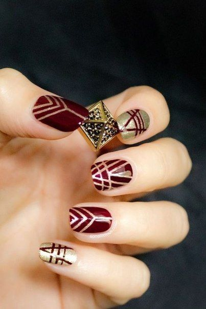 "Manicure in the style of Art Deco – what can be more refined? The best choice for a glamorous party in honour of the film ""The Great Gatsby."" Besides this burgundy become one of the trends of 2015, the color of old gold never loses its relevance and combined together they produce the ""wow!"" effect."