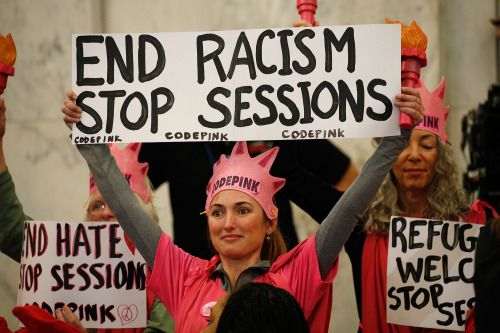 Protesters disrupt Sen. Jeff Sessions confirmation hearing on... Protesters disrupt Sen. Jeff Sessions confirmation hearing on Capitol Hill Protesters disrupted Sen. Jeff Sessions confirmation hearing for attorney general on Tuesday including two men wearing Ku Klux Klan costumes and a woman wearing a pink crown. The conservative Alabama senator who is Donald Trumps pick for the nations top law enforcement official faces concerns over how committed he would be to civil rights. The…