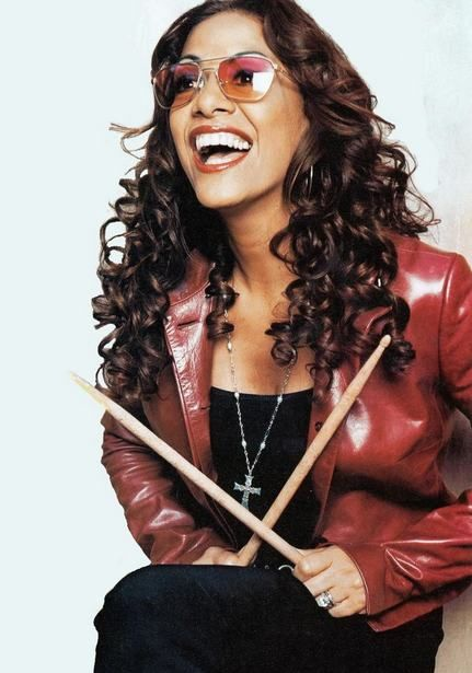 Sheila E....love her! Auntie Shelia Escovedo The Lovely Mulatto-Meztiza The Female Virtuoso of The Latin Percussion -Dad Pete Escovedo  , In The Studio at age 17 Recoded with George Duke a Host of Others Inc Lionel Richie and of Course Prince and Lionel Richie and Aunt to Nicole Richie and Stunningly Gorgeous  !! Girly is TOO HOT !!