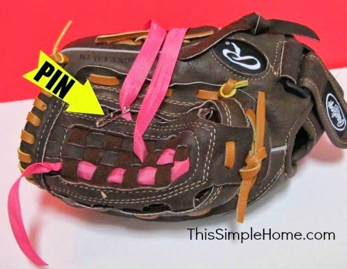 DIY Personalized Girly Softball Glove.  Add a little color to a brown glove with ribbon.