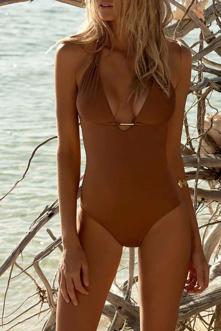This venturesome bronze halterneck swimsuit from Melissa Odabash lauds the contemporary elements of luxury swimwear. The Casablanca features a double strap and an alluring plunging v-neckline that converges on a thin golden crosspiece at the bust. The crosspiece is embossed with the coveted Odabash insignia.    Plunge Halterneck Swimsuit by Melissa Odabash. Clothing - Swimwear - Two-Piece Miami, Florida