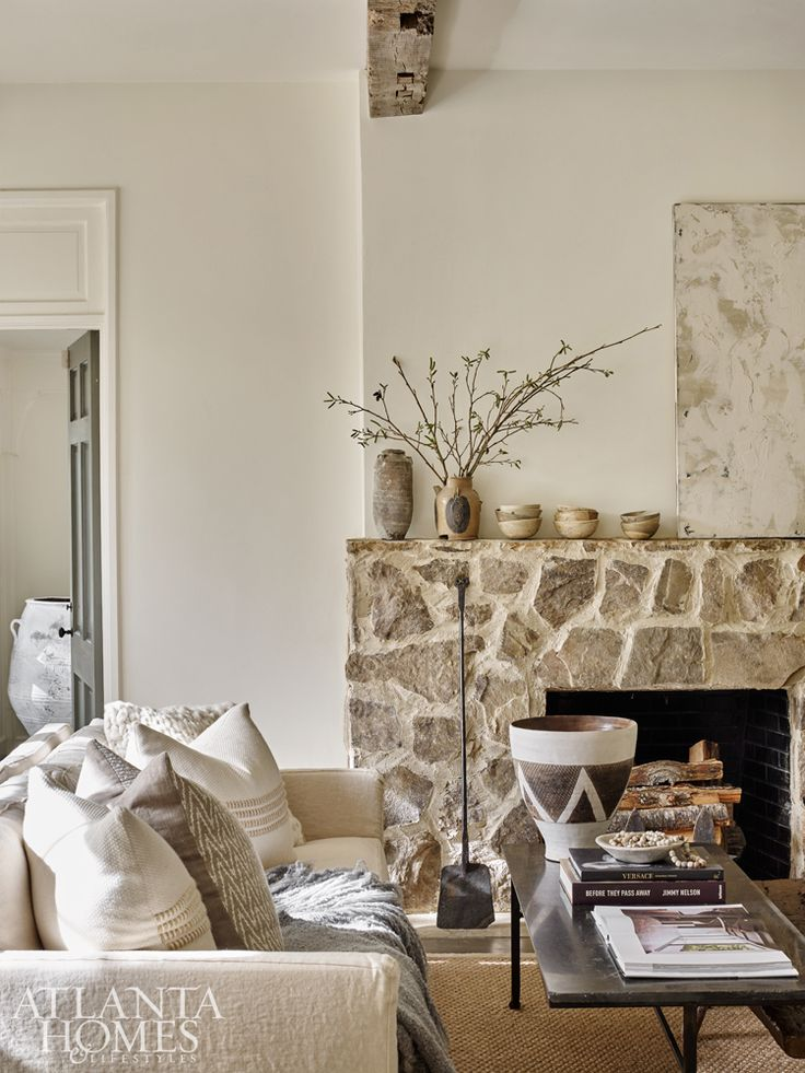 The Weitzes added antique beams and a stone fireplace to the formal living room in a recent renovation. The mantel features one-of-a-kind Asian pottery Debbie has on display at B.D. Jeffries, but it is not for sale. Olive jar, pillows and throw from B.D. Jeffries.