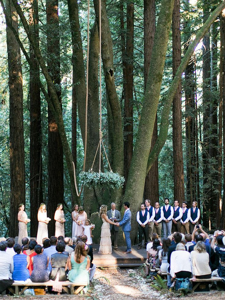 Suspend a woodland-inspired chandelier over the wedding couple at the altar for a whimsical accompaniment to the outdoor ceremony.