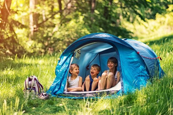 From 4-star family resorts to rustic sites with outdoor showers, here are 50 popular camping and caravan spots the whole family will enjoy.