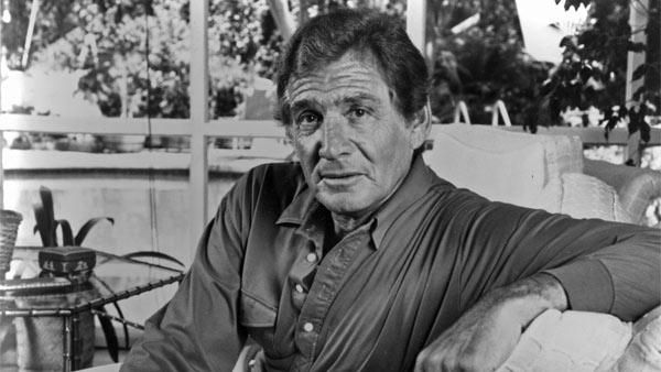 """In a 1986 file photo provided by ABC, Gene Barry poses for a photo to promote his appearance on """"Fame Fortune & Romance."""" Gene Barry has die..."""