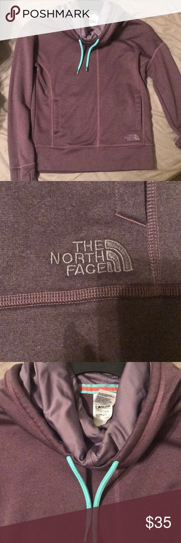 Purple north face sweatshirt Purple sweatshirt with teal jaw strings. Sort of like a turtle neck, but rolls down. Great condition! North Face Jackets & Coats