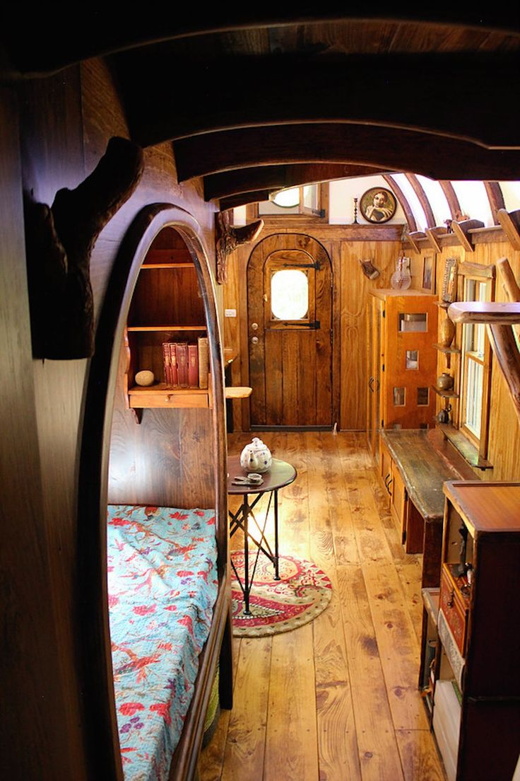 a 204 square feet tiny house with hand carved interior woodwork throughout in kerhonkson