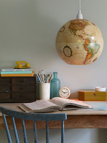 We're positively glowing over this new use for an old globe. #countryliving #crafts