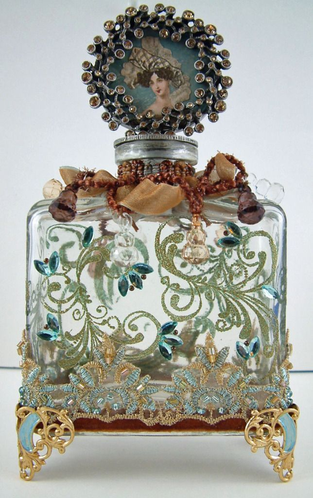 DIY Altered Perfume Bottle >> http://artfullymusing.blogspot.com/2011/12/altered-bottle.html