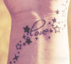 Word tattoo & stars   b&w   wrist