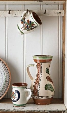Pitcher and mug made of a red clay and glazed in traditional Romanian folk patterns