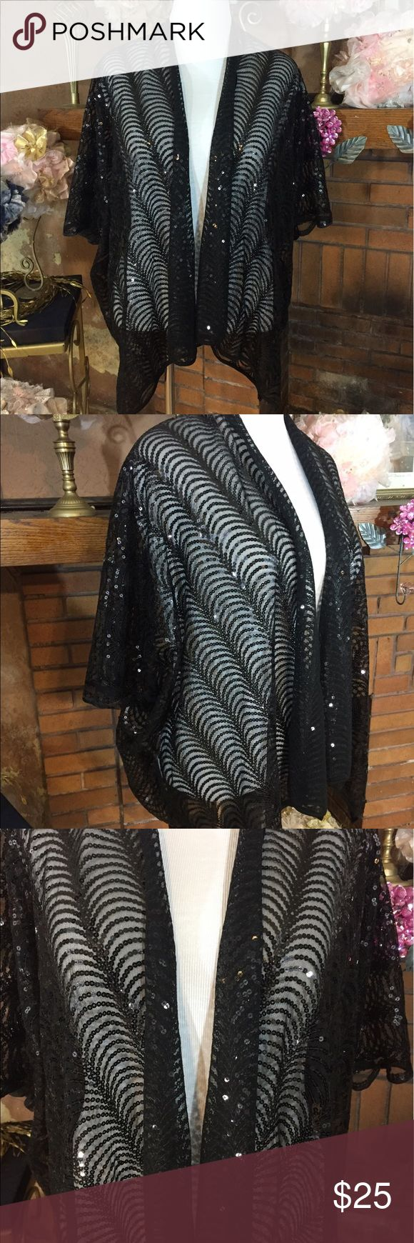 Cejon black sheer sequin cardigan Cejon black sheer sequin cardigan One Size Fits Most. 100% Polyester. Approx 28 inches long. There are flowy sleeves. Would be great with a formal dress or even with jeans and a top for a night out. Very versatile. New with tags. Please check out all pictures. Read full description of the items. To ensure a happy shopping experience, please ask me any questions. Cejon by Nordstrom Rack Sweaters Cardigans