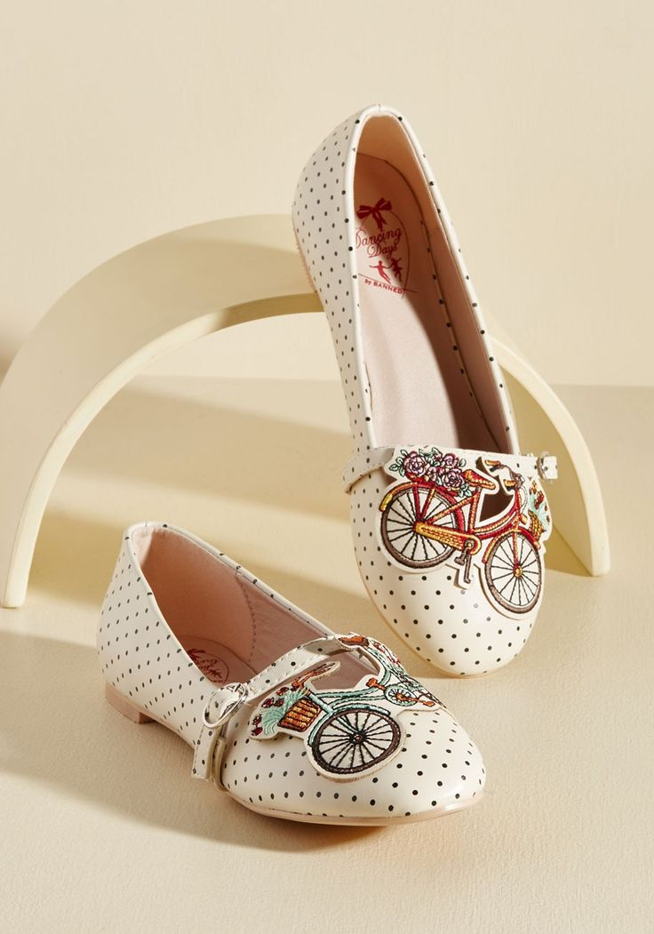 Make Great Rides Flat | Mod Retro Vintage Flats | ModCloth.com  Make every trip a treat by sporting these ivory flats from Banned! Decorated with dainty black polka dots, boasting silver-buckled straps, and infused with charm from the orange, green, and red embroidered bicycle details, this peppy pair has serious style that lasts for miles and miles!