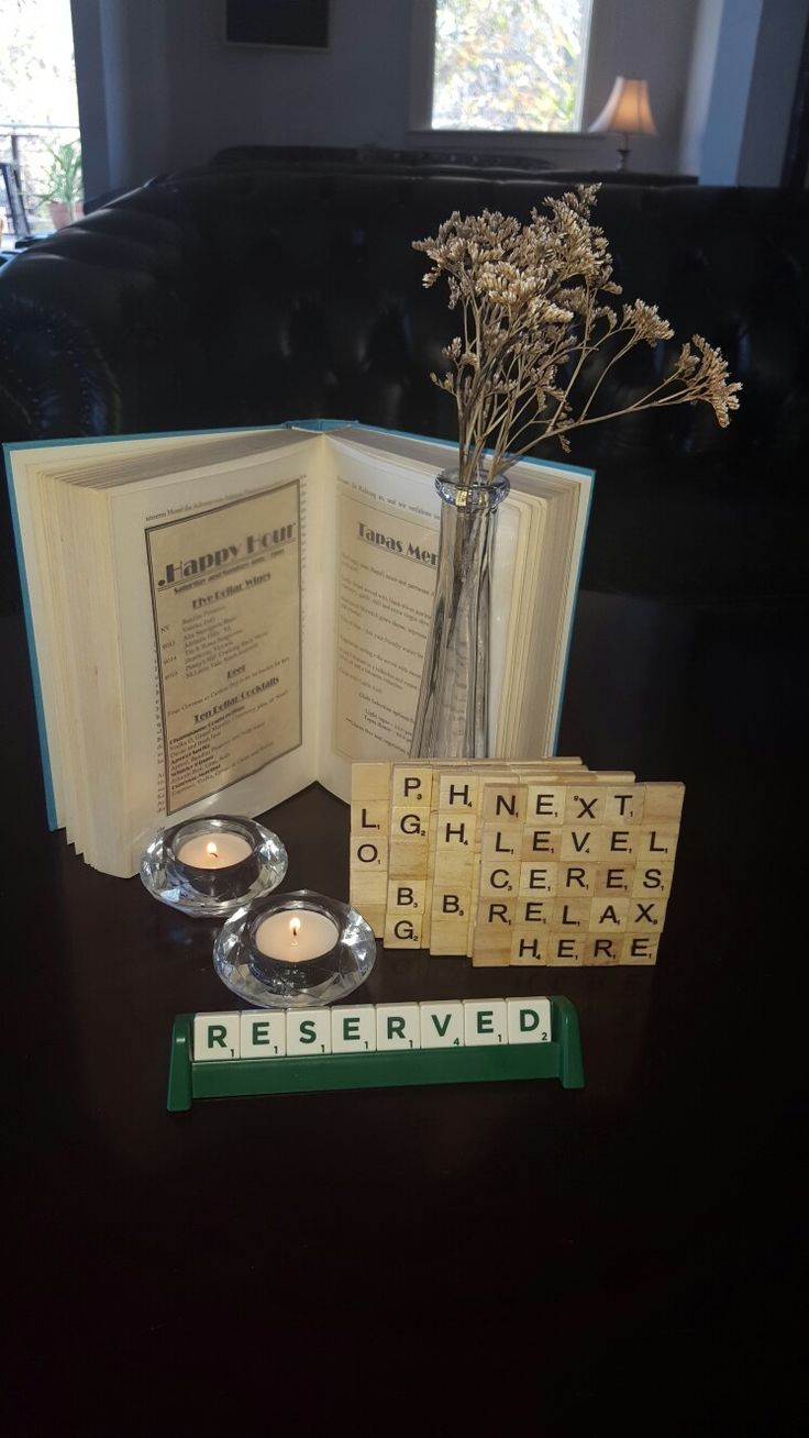 Creative table settings. Reserved sign, scrabble coasters and book menus