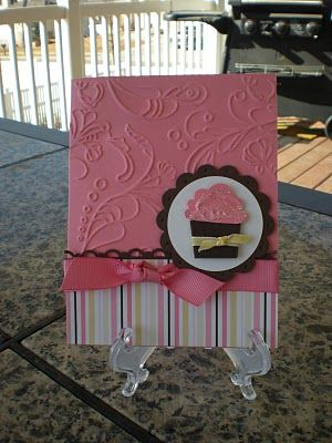 This card uses the Elegant Lines Embossing folder, Create a Cupcake stamp set and punch and some old DSP