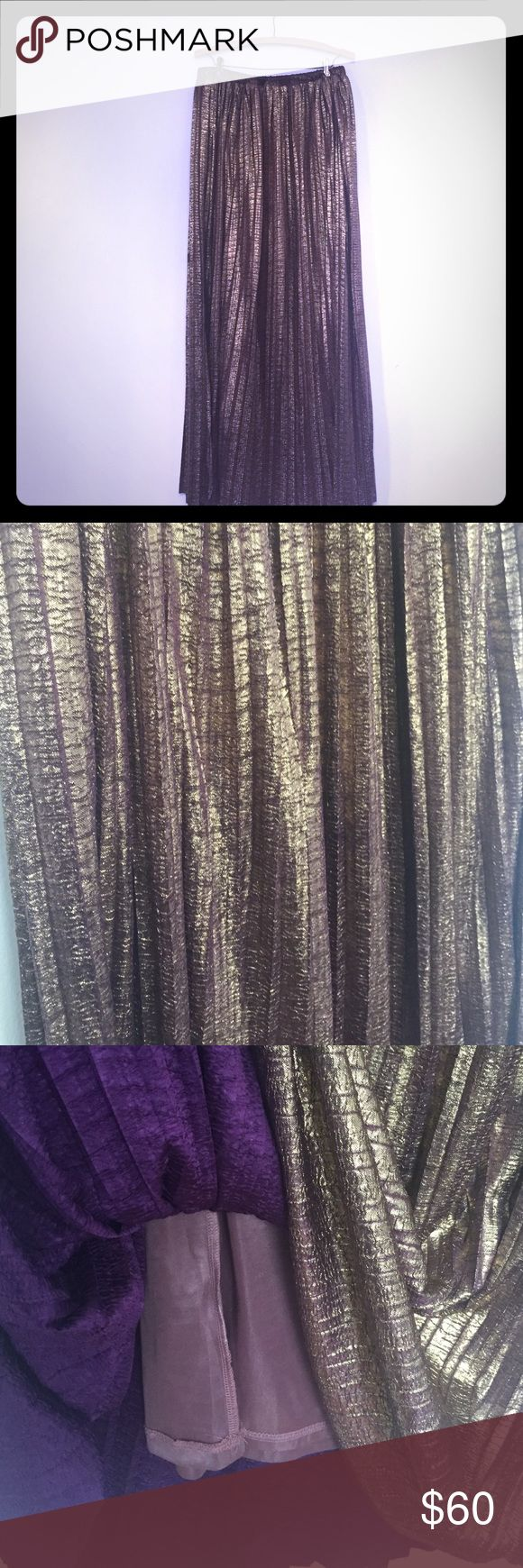 "Urban Outfitters Metallic Purple Maxi Skirt Beautiful flowy metallic purple maxi skirt with elastic purchased via Urban Outfitters. Women's size medium- but can fit a large or xl. Gently used condition - 41"" long. Urban Outfitters Skirts Maxi"