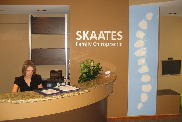 Skaates chiropractic custom interior wall logo Chiropractic office designs