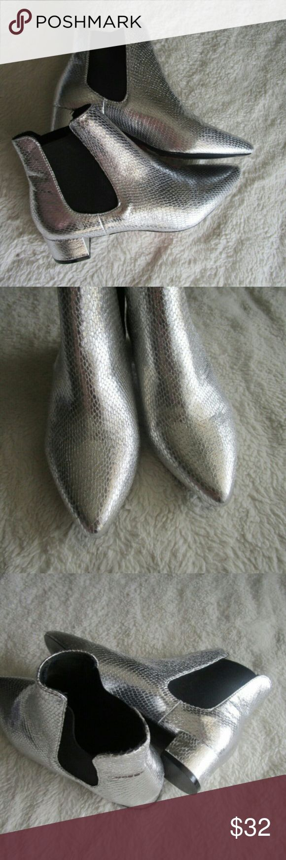 "SALE New TopShop Silver ChelseA Ankle Boots 6.5 These booties are TopShop Silver Chelsea KRAZY Pointed Ankle Booties   They a modest block heel that adds authentic flair to a classic Chelsea boot crafted with a trend-right pointy toe. So cute and they definitely stand out! They are silver with black elastic!  - 1 1/2"" heel  - 5 3/4"" shaft   -Textile upper/textile and synthetic lining/synthetic sole  Women's Size 6.5 / Euro 37   Brand new! Topshop Shoes Ankle Boots & Booties"