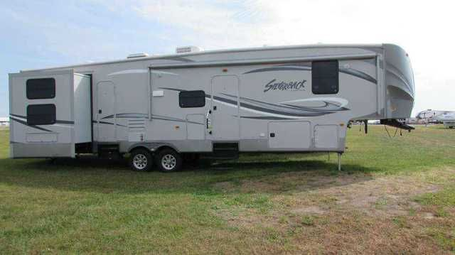 2013 Used Forest River Cedar Creek Silverback 35QB4 Fifth Wheel in Missouri MO.Recreational Vehicle, rv, 2013 Forest River Cedar Creek Silverback 35QB4, 2013 Cedar Creek Silverback bunkhouse. 4 slides, 2 bathrooms, huge bunk room in back that is perfect for kids. Fireplace in living room. Includes master bedroom and living room t.v.'s. GREAT condition. If you have seen what these sell for new, you will love this price and how nice this camper is. Dealer prices are much, much higher for this…