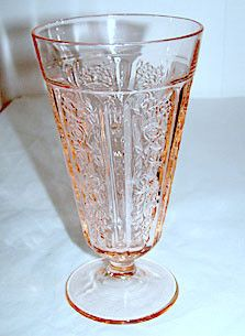 These are Depression Glass footed ice tea tumblers in the Sharon or Cabbage Rose pattern made by Federal. They stand 6.5 inches tall and holds 15 oz. They are in very nice condition with no chips or c