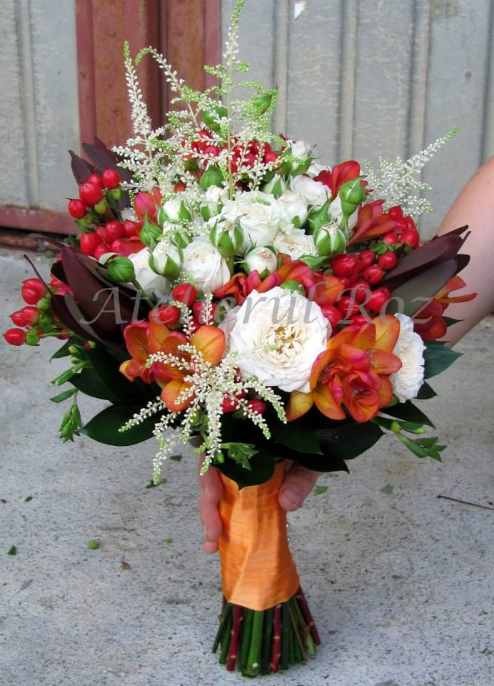 Red, white, orange bridal bouquet with roses, freesia and hypericum