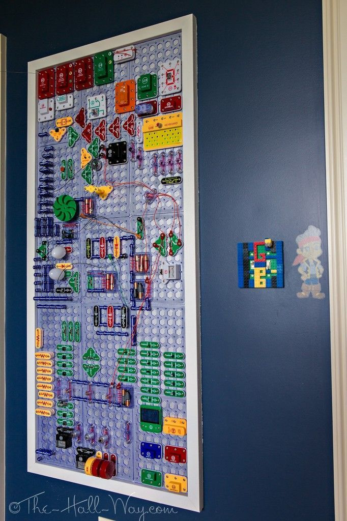 Elenco Snap Circuits Wall Board - Mounting the Snap Circuits boards to the wall makes for a brilliant storage solution, plus it makes it easy for multiple students to tinker with them at the same time.