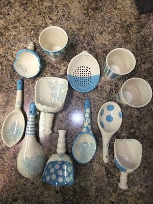 One idea is to make different shapes; same glaze. Notice each spoon has a hole in the handle for hanging. Maybe a composition display...