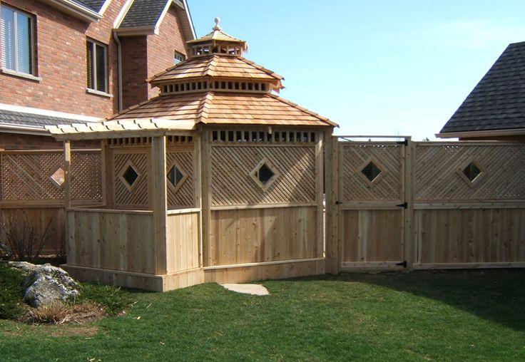 Custom cedar gazebo and fence by Flamborough Patio