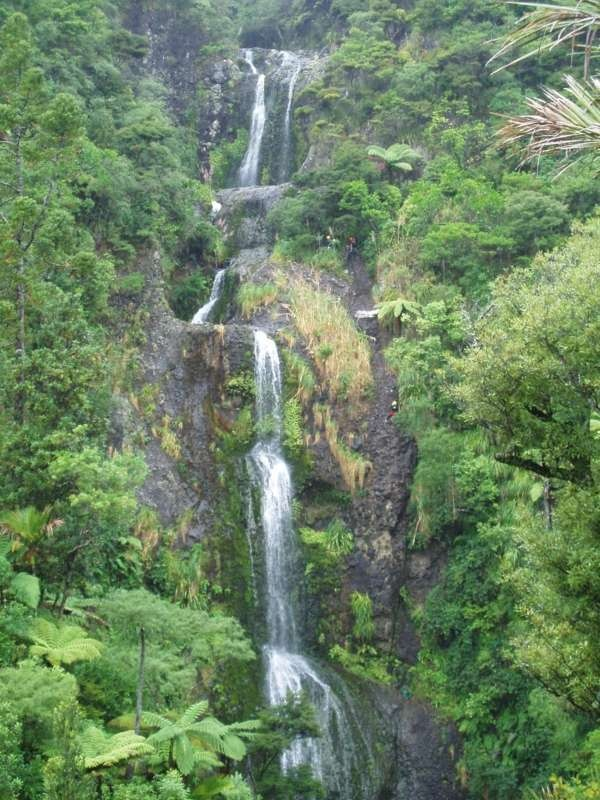 Repelling down waterfalls and canyons with AWOL Adventures in Auckland, NZ (you can kind of see people repelling - amazing experience)