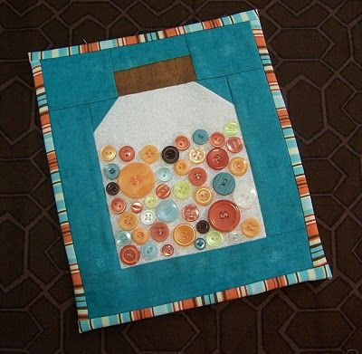 Quilted button jar. Perhaps make an entire quilt from these blocks with bugs instead of buttons
