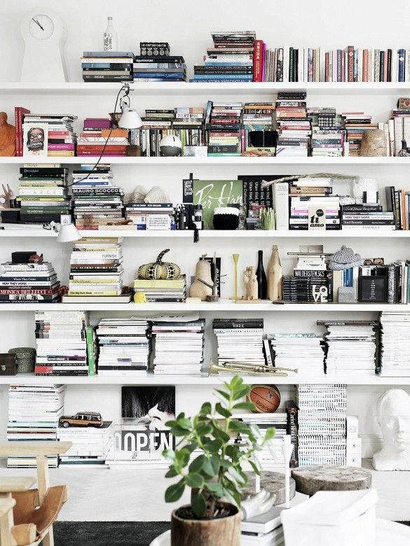 Floor to ceiling styled bookshleves