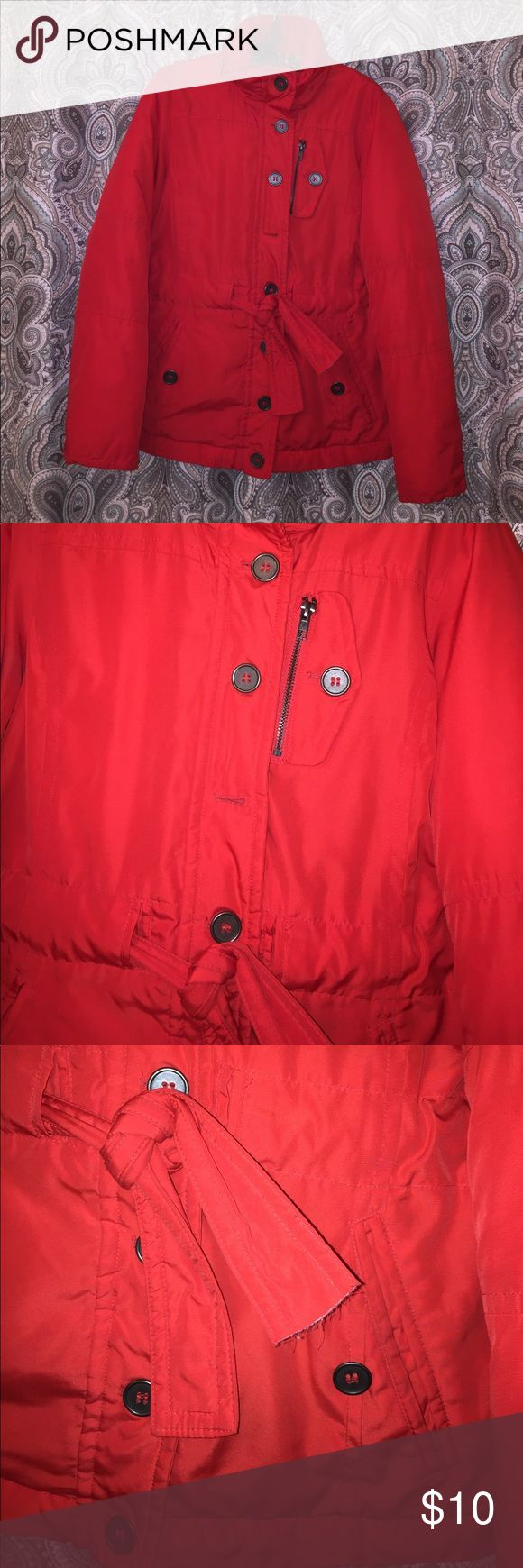 Bright orange jacket Water resistant coat, buttons up but is missing a button right in the middle. Has a zipper across the back of the neck with a hidden hood inside. The belt that ties around the waist, I cut it for some reason so the end of one side is frayed unfortunately. I would still wear it, but it is too small for me. There are secret pockets hidden on the inside, two regular pockets on the outside and another tiny zipper pocket by the chest. ana Jackets & Coats