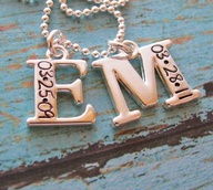 I WANT! first letter of your childs name with their birthday engraved on it. LOVE!!!