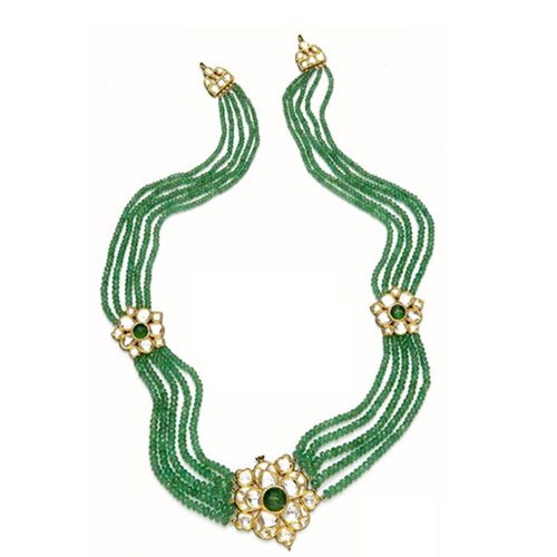 5 strand emerald necklace with uncut diamond floral motif.