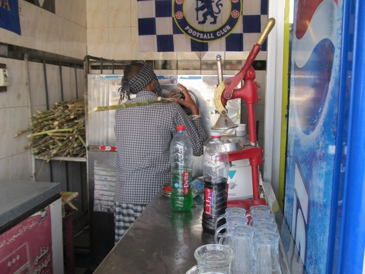 Cane sugar juice shop. Freshly squeezed with a squirt of Lemon juice.