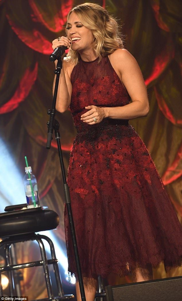 Leading lady: The American Idol winner opted for a sequined red frock, adorned with lace fabric, that highlighted her svelte waist
