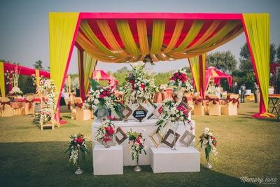 frames decor, floral decor, photobooth ideas, red and yellow tents