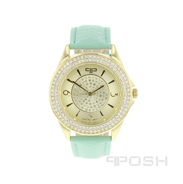Nelly - Watch - Gold Tone and Teal Strap.  - Beautiful modern face design - Made with genuine leather wrist strap - Face features exclusive POSH design - Full casing made in stainless steel and plated with yellow gold tone - Embellished with sparkling clear stones - Water resistant up to 5 ATM - Replacement straps available - Japanese movement  Dimensions Face: 30mm diameter   POSH by FERI - Passion for Fashion - Luxury fashion jewelry for the designer in you.  #Jewellery   #watches