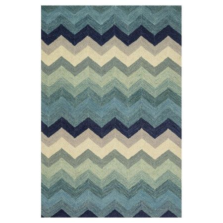 Stylishly anchor your living room seating group or master suite ensemble with this artfully hand-hooked wool rug, showcasing an eye-catching chevron motif.