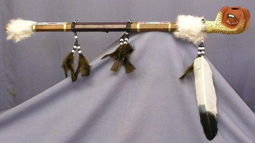 eagle claw peace pipe with a fired clay bowl