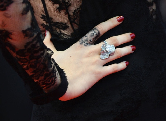 Cara Delevingne's lion head tattoo at Cannes red carpet.