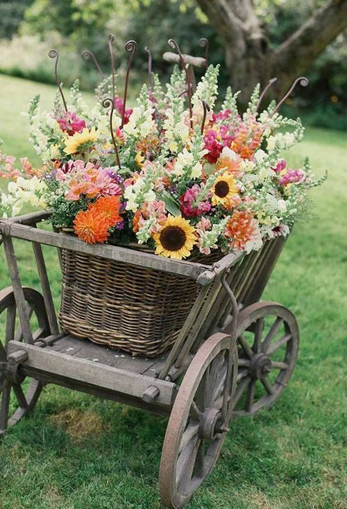 small wagon with a basket of  Flowers   Beautiful!!!!