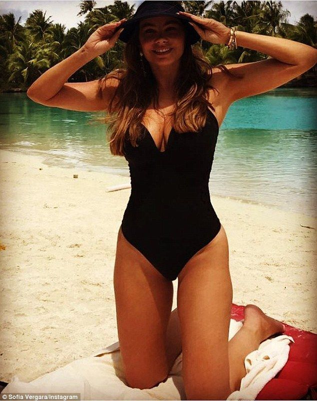 Amazing figure: On Saturday, the stunner slipped on another swimsuit, this time a classic black one-piece
