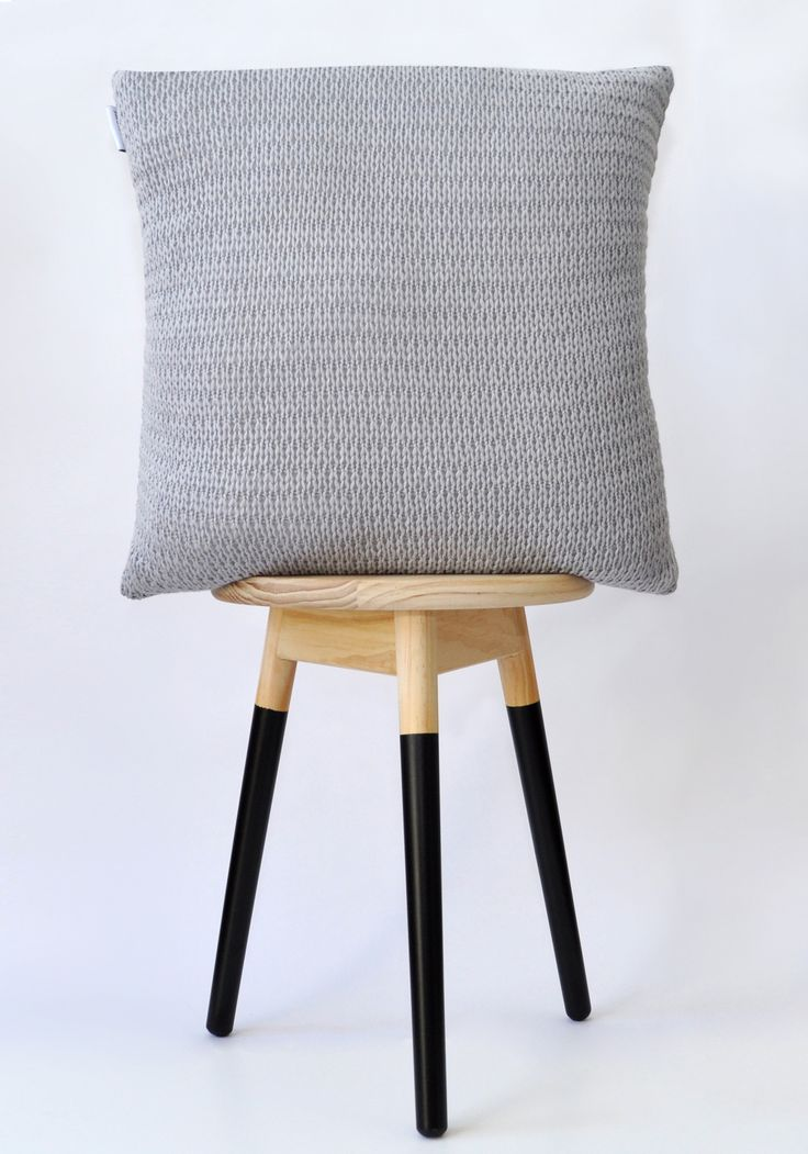 Grey knitted cushion cover.